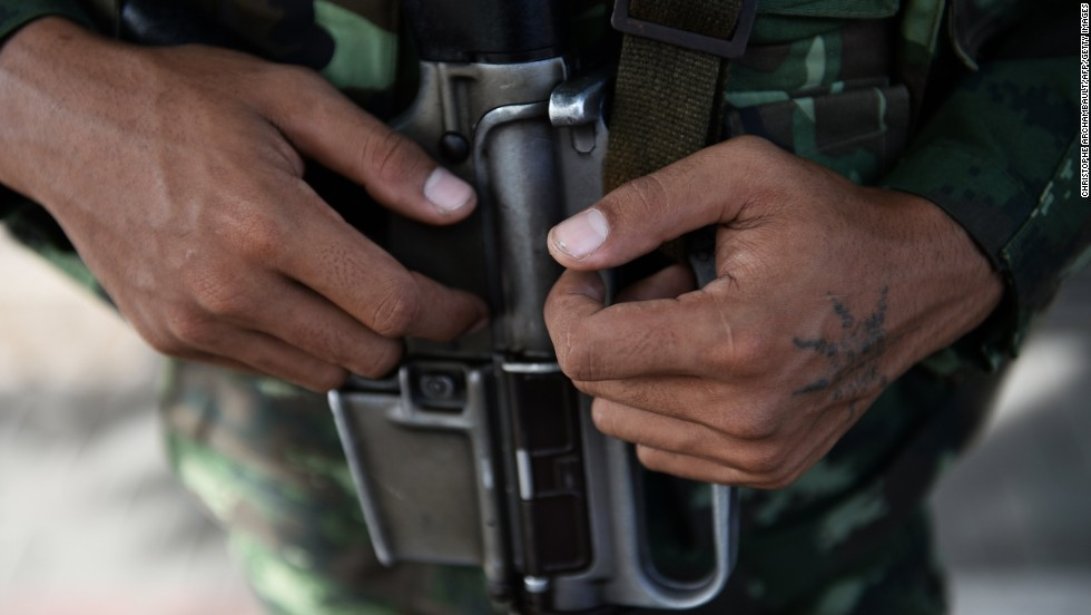 A soldier grips his gun outside the Government Public Relations Department building on May 20.