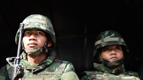 Soldiers hold their positions outside the Government Public Relations Department building on May 20.