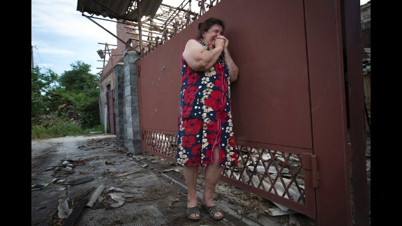 Yekaterina Len cries outside her home after it was hit by mortar shells during fighting between pro-Russian separatists and Ukrainian soldiers in Slovyansk on Tuesday, May 20.