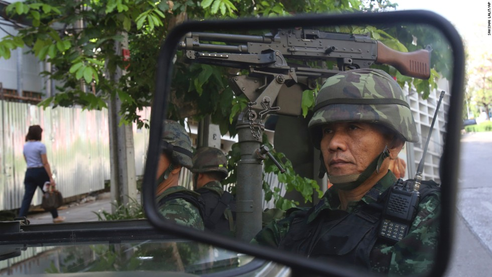 Thai soldiers guard the Thai police headquarters in Bangkok on Tuesday, May 20.