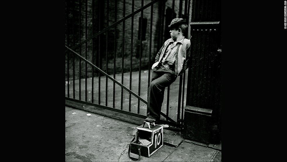 "<em>Shoe Shine Boy -- Mickey with his shoe shine stand, 1947</em><br /><br />The editors of <em>Look</em> frequently commissioned photo essays of actors and other glamorous people at home. But in this unpublished series for the magazine, Kubrick followed a 12-year-old shoe shine boy named Mickey. <br /><br />""For this story he picked an ordinary child who is behaving like an adult because he is working all the time,"" says Ortner-Kreil. ""The first photos show him in his professional surroundings counting change, waiting for a client, and shining shoes. Kubrick was only five years older than Mickey, and you can feel some connection between the two."""