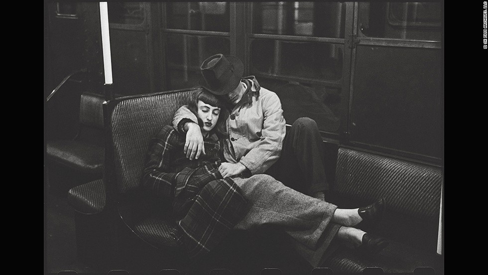 "<em>New York Subway -- Young lovers, 1947</em><br /><br />Kubrick was intrigued by the New York subway as a place of transit where people from diverse backgrounds encountered one another. He shot many of these images between midnight and six in the morning.""The images showing sleeping passengers are carefully arranged,"" Ortner-Kreil says. ""Behind many, there is composed direction, as demonstrated in this shot of two lovers. The young man slides his hand under his girlfriend's coat. The photographer, and therefore also the observer, become voyeurs...Kubrick used to work with friends who acted as 'protagonists' for those shots."""