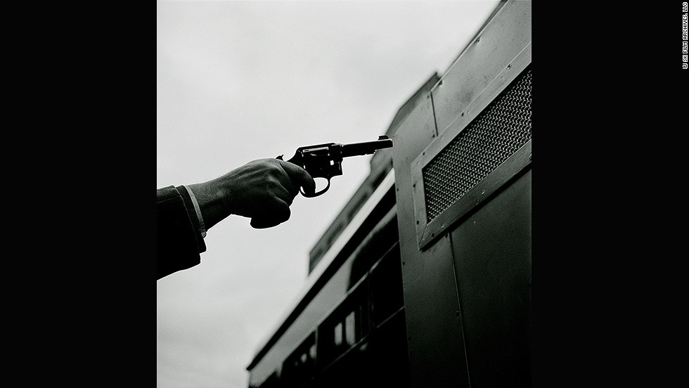 "<em>Paddy Wagon -- Gun, 1948</em><br /><br />Kubrick was familiar with photos of police work and criminality, which were popularized by the photographer <a href=""http://en.wikipedia.org/wiki/Weegee"" target=""_blank"">Weegee</a>. <br /><br />""But while Weegee's images are characterized by their hard realism and a somewhat voyeuristic brutality, Kubrick offers <em>Look</em>'s readership a violence-free, object-interested and precisely arranged image of criminality. He works with cinematic features like the cut or the close-up.""<br /><br />This image shows a gun pointed at a Paddy Wagon, a vehicle that transported 700 prisoners a day in New York City."