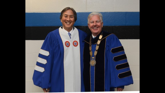 Howard Koh, assistant secretary for health of the U.S. Department of Health and Human Services, left, addressed graduates during a commencement ceremony at University of Massachusetts Lowell on May 17. He posed here with Marty Meehan, chancellor of the university.