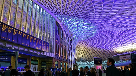 "Although London's King's Cross railway station in opened in 1852, its new 1,700-ton steel and glass dome has given it a breathtakingly futuristic edge. Many know this station as the location of the fictional ""Platform 9 3/4"" in the Harry Potter novels, like Timothy Holm, who took this photo."