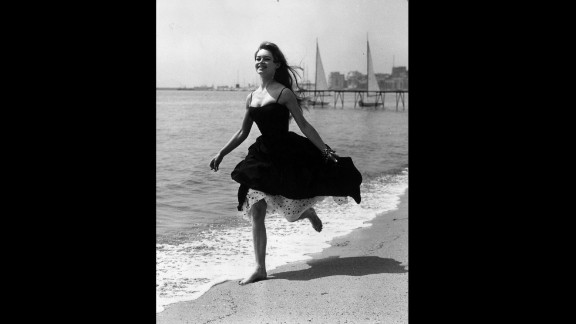 """Film star Brigitte Bardot eschews footwear altogether and runs barefoot on a beach in Cannes during the 1956 festival, where """"The Silent World"""" by Jacques-Yves Cousteau and Louis Malle won the Palme d"""