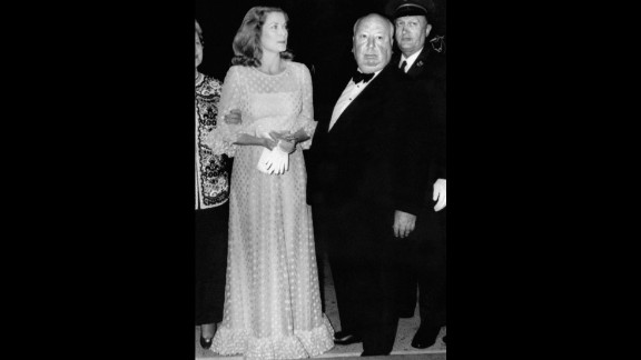 """Grace Kelly poses with director Alfred Hitchcock during the 1972 Cannes Film Festival. The pair worked together on three films, """"Dial M for Murder"""" (1954), """"Rear window"""" (1954) and """"To Catch a Thief"""" (1955) before she gave up her acting career at 25 to focus on her duties as Princess of Monaco."""
