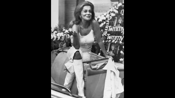 Swedish-American actress Ann Margret rides around the streets of Cannes in all white during a photo call in 1975. Margret used her backcombed hair and white leather boots to promote British film director Ken Russell