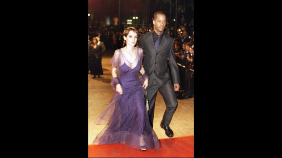"""U.S. actress Winona Ryder arrived at the 51st Cannes film festival with a man she would not reveal the identity of. She did however reveal her love of tulle. The pair attended the gala screening of """"Fear and Loathing in Las Vegas"""" directed by Terry Gilliam."""