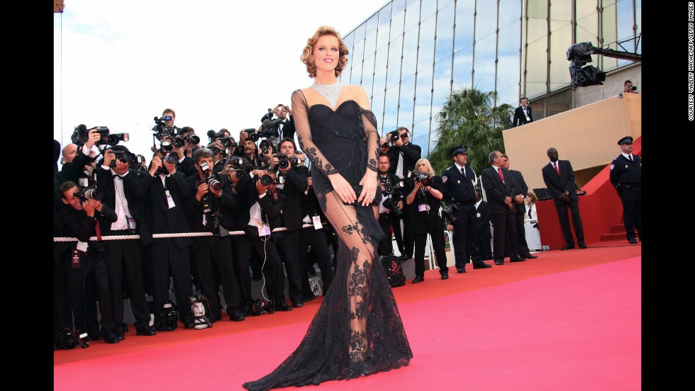 "Czech model Eva Herzigova raised a few eyebrows in this exposed lacy gown, but was forgiven, because it's Dior. She also made everything better by accessorizing with Chopard jewelery. The picture was taken as she arrived at the screening of U.S. director Steven Soderbergh's film ""Che"" at the 61st Cannes International Film Festival in 2008."