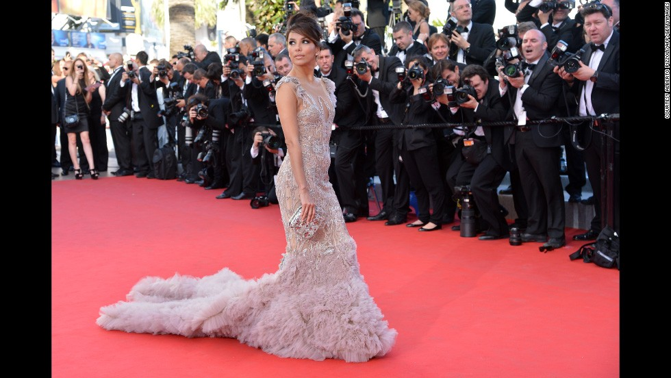 Eva Longoria takes up more than her fair share of carpet as she arrives for the opening ceremony of the 65th Cannes film festival in Marchesa. Long dresses work best for Eva who had a wardrobe malfunction the year after, failing victim to the high stairs at the festival.