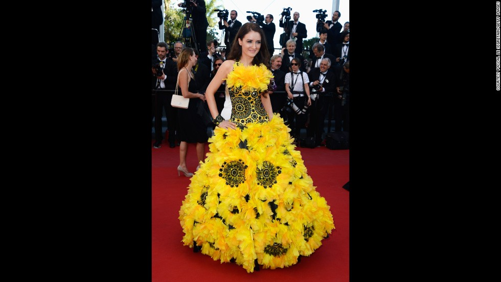 "In 2013 two guests put the celebrities to shame with their striking outfits. The first was this sunflower inspired gown worn at the ""Zulu"" premiere and closing ceremony during the 66th Annual Cannes Film Festival 2013."
