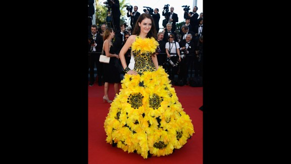 """In 2013 two guests put the celebrities to shame with their striking outfits. The first was this sunflower inspired gown worn at the """"Zulu"""" premiere and closing ceremony during the 66th Annual Cannes Film Festival 2013."""