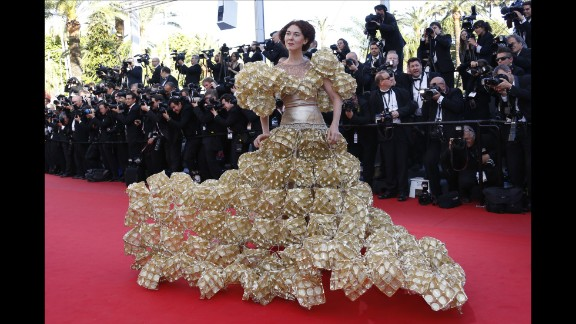 """The second guest who relegated the celebrities to mere mortal status wore a dress made of biscuit trays to the screening of """"The Past"""" at the 66th edition of the Cannes Film Festival."""