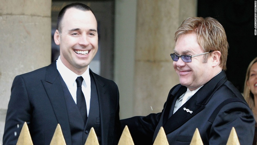 "Elton John and David Furnish enjoyed a civil partnership ceremony at Windsor Guildhall in Windsor, England, in 2005. The two<a href=""http://www.people.com/article/elton-john-david-furnish-wedding-photos"" target=""_blank""> married at the end of 2014.</a>"