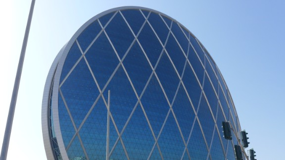 Completed in 2010 in Al Raha Beach, United Arab Emirates, the Aldar Headquarters building resembles a glass-covered wheel. The 23-story office space follows LEED standards for environmentally exceptional buildings. It has has become a city landmark, says Devi Trianna, who predicts the cities of the future will be more environmentally friendly.