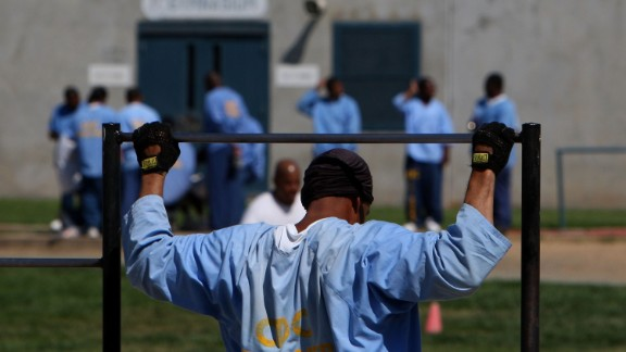 Caption:IONE, CA - AUGUST 28: An inmate at the Mule Creek State Prison exercises through pull-ups in an outside yard August 28, 2007 in Ione, California. A panel of three federal judges is looking to put a cap on the California State Prison population after class action lawsuits were filed on behalf of inmates who complained of being forced to live in classrooms, gymnasiums and other non-traditional prison housing. California prisons house nearly 173,000 inmates with over 17,000 of them in non-traditional housing. The Mule Creek State Prison has had to modify several facilities to make room for an increasing number of inmates.