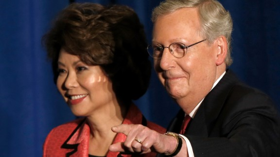 LOUISVILLE, KY - MAY 20:  U.S. Senate Republican leader Sen. Mitch McConnell (R-KY) and his wife Elaine Chao arrive for a victory celebration following the early results of the state Republican primary May 20, 2014 in Louisville, Kentucky. McConnell defeated Tea Party challenger Matt Bevin in today