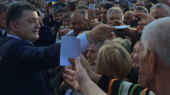 Presidential candidate Petro Poroshenko hands out autographs on the campaign trail in central Ukraine in the run-up to the election on May 25.