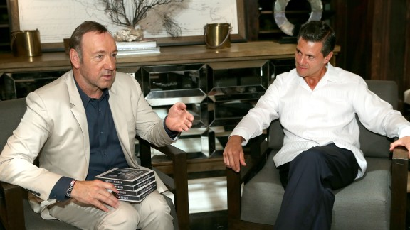 """Kevin Spacey (left) met with Mexico President Enrique Pena Nieto and signed a DVD box set of his series """"House of Cards"""" in May 2014 in Cancun, Mexico."""