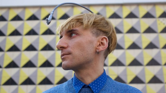 Neil Harbisson -- a contemporary artist born with color blindness -- has hacked a camera to pick up colors and transmit it to his ear as a musical note, via bone conduction. He calls it his Eyeborg.