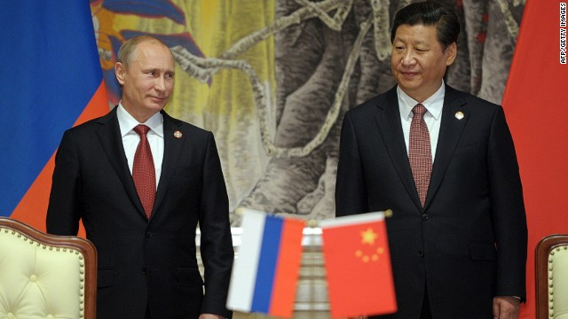 China's President Xi Jinping (R) and Russia's President Vladimir Putin attend an agreement signing ceremony in Shanghai on May 21, 2014. China and Russia signed today a monumental, multi-decade gas supply contract in Shanghai, Chinese state energy giant CNPC said, with reports saying it could be worth as much as $400 billion. AFP PHOTO / RIA-NOVOSTI / POOL ALEXEY DRUZHININALEXEY DRUZHININ/AFP/Getty Images