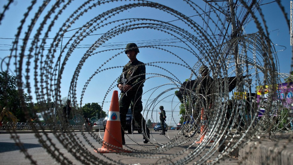 Thai soldiers stand guard at a checkpoint outside of Bangkok on May 22.
