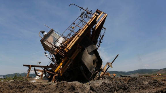 Bosnian workers inspect the damage on heavy machinery after devastating flooding at a coal mine in the village of Sikulje on Thursday, May 22. Heavy rainfall in Serbia and neighboring Bosnia-Herzegovina has resulted in the worst flooding since records began 120 years ago, meteorologists say.