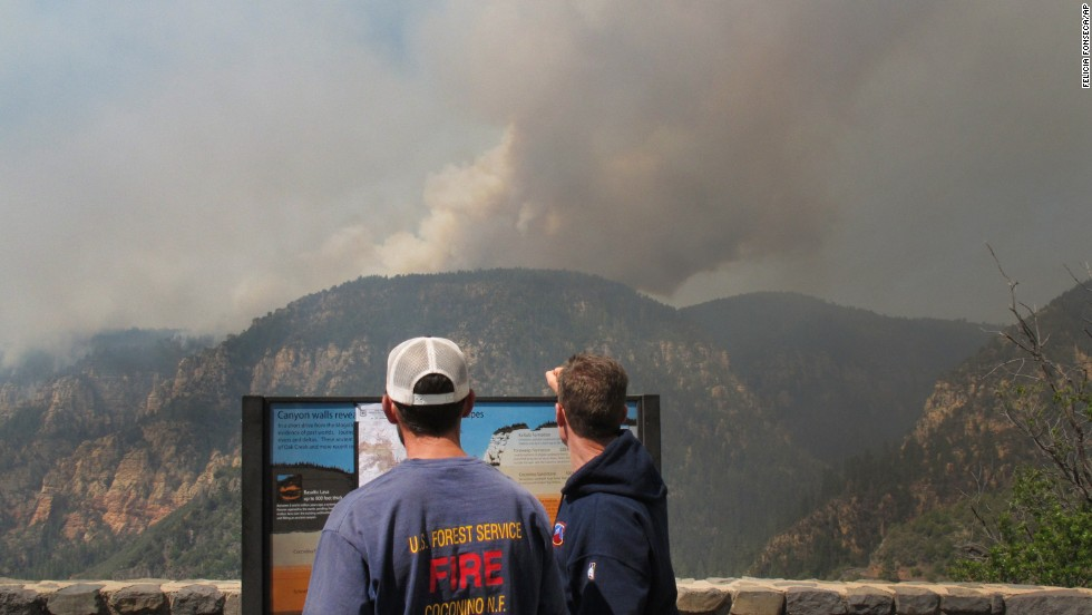 Coconino National Forest Battalion Chief Preston Mercer, left, and fire information officer Bill Morse survey the fire burning in Oak Creek Canyon, Arizona, on Wednesday, May 21.
