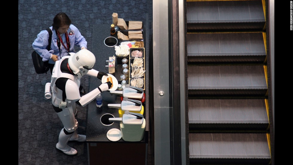 "A man dressed as a ""Star Wars"" stormtrooper prepares a hot dog during the 2011 WonderCon in San Francisco."