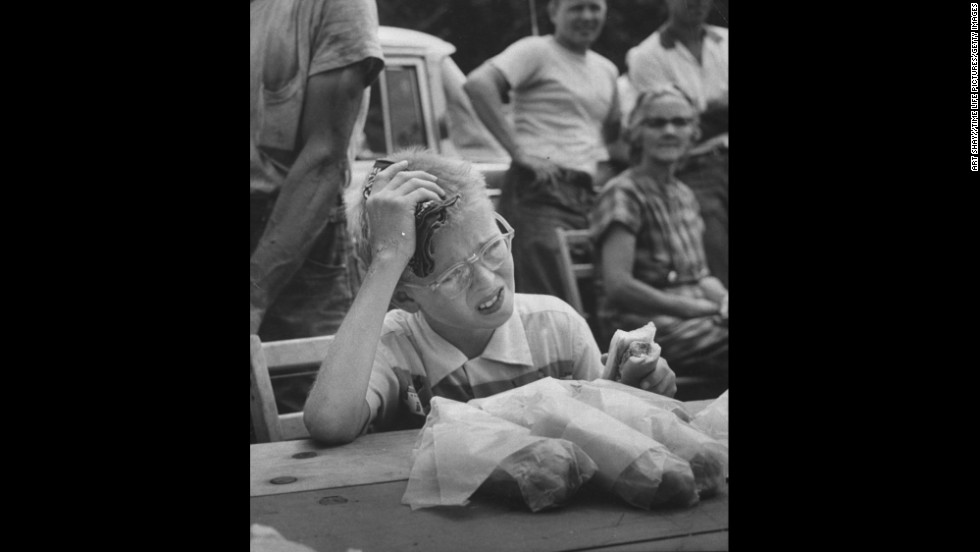 David Dittman winces as he competes in a hot dog eating contest in Danville, Illinois, in 1957.
