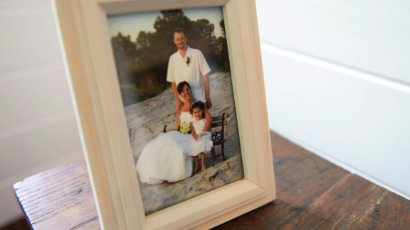 """A 2006 portrait of the Kolbeck family on Dane and Suzannah's wedding day sits inside Sicily's tiny house. In a post on her tiny house blog, La Petite Maison, Sicily wrote, """"If you have a blank wall, you don't need fill it up with meaningless pictures. Tell a story with your space."""""""