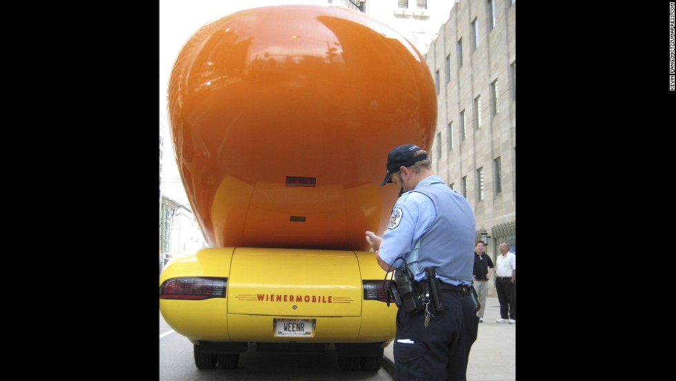 A Chicago police officer writes a traffic ticket for the Oscar Mayer Wienermobile in 2007.