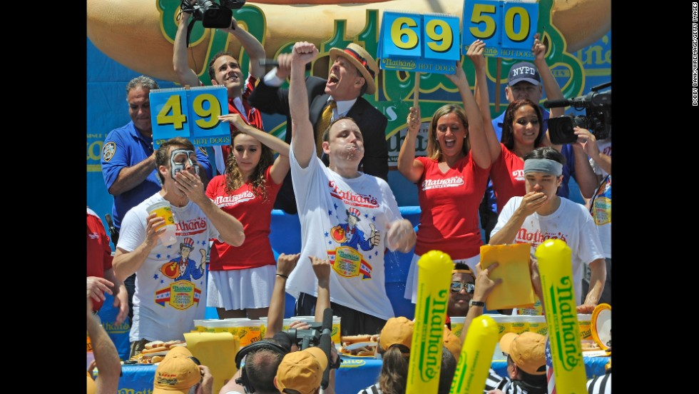 From left, Tim Janus, Joey Chestnut and Matt Stonie compete in the Nathan's hot dog eating contest in 2013.
