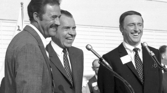 "The 1968 presidential campaign went down to the wire, and little things may have made the difference -- such as Richard Nixon, the Republican candidate, going on the popular ""Rowan and Martin's Laugh-In"" to say one of the show's catchphrases: ""Sock it to me."" Here, Nixon is flanked by Dan Rowan, left, and Dick Martin at an event in October 1968."