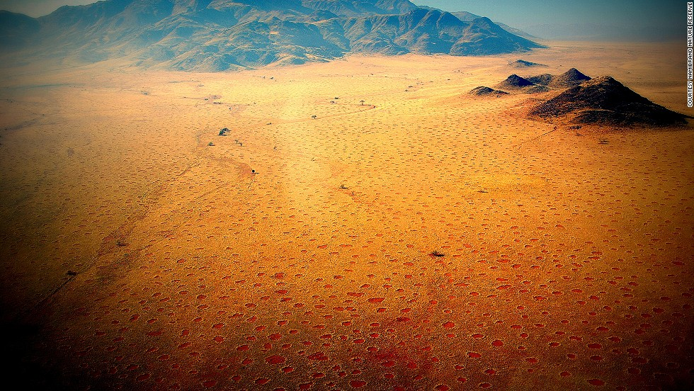 Strange barren dots -- rimmed with tall grasses -- sprinkle a 1,100-mile stretch of Namibia's desert.