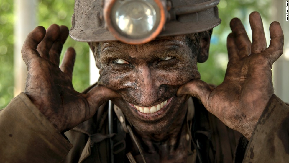 A Ukrainian coal miner smiles after finishing his shift at a mine outside Donetsk, Ukraine, on Tuesday, May 20.
