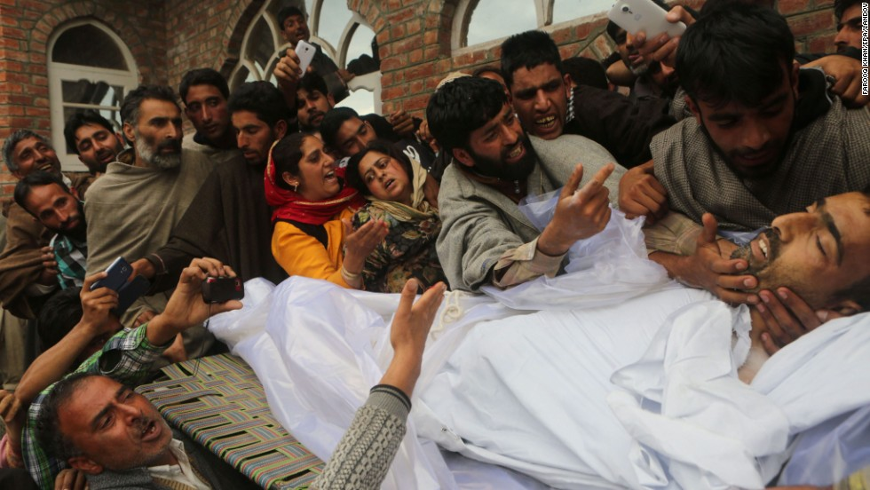 Relatives mourn near the body of Indian Army soldier Mushtaq Ahmad Mir during his funeral procession in Qazipura, India, on Tuesday, May 20. He was killed and three others were wounded when militants fired upon them.
