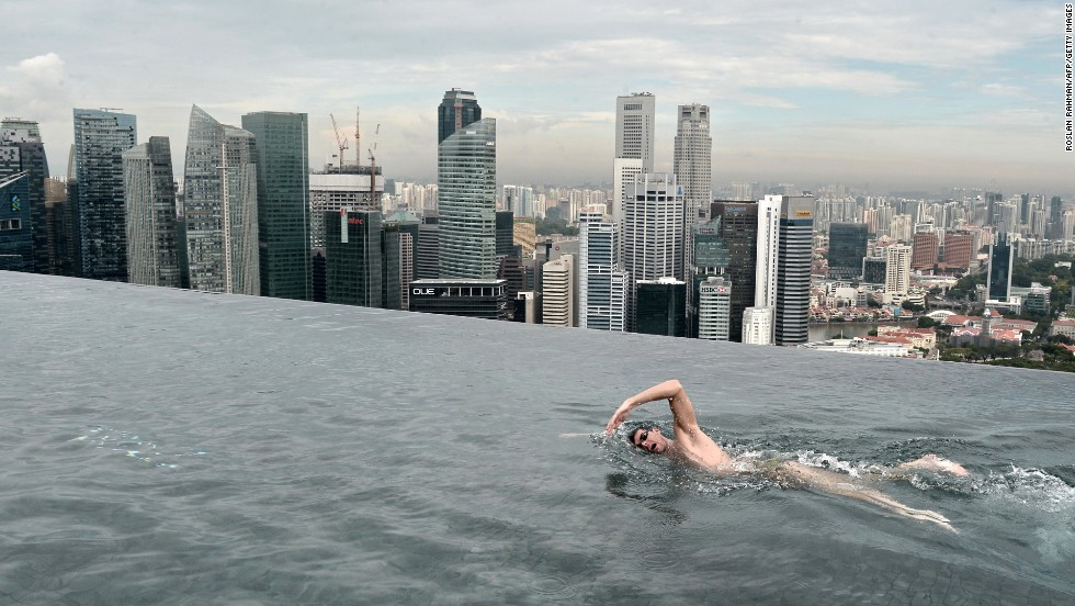 World champion swimmer Christian Sprenger of Australia swims on the rooftop pool of the Marina Bay Sands hotel in Singapore on Tuesday, May 20. Sprenger was holding a swimming clinic for special-needs children as he promoted the Singapore Swim Stars festival in September.