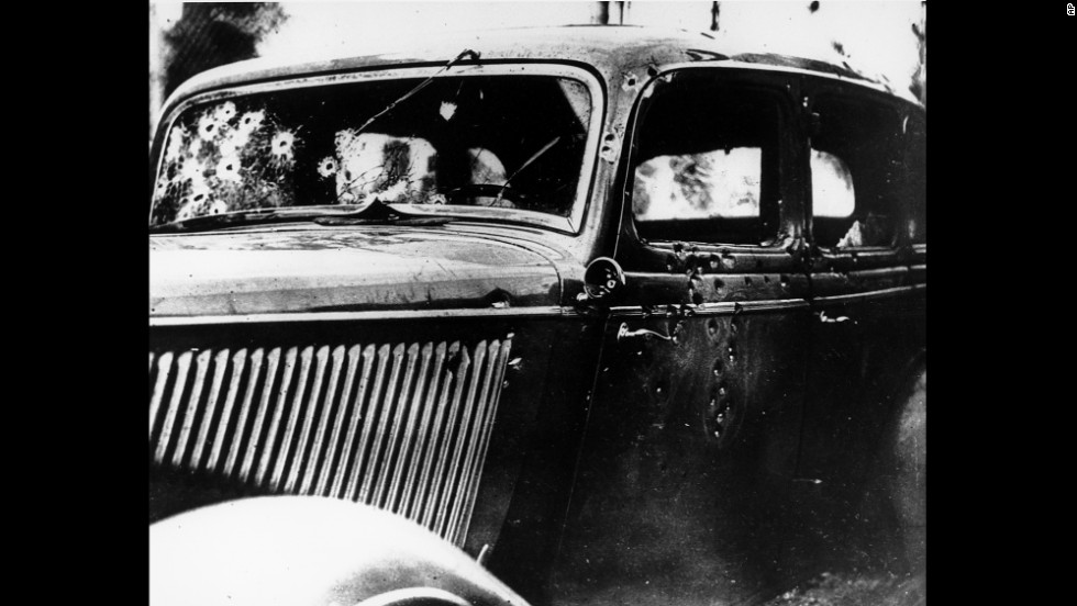Bullet holes riddle the tan Ford that Bonnie and Clyde were driving when they were ambushed.
