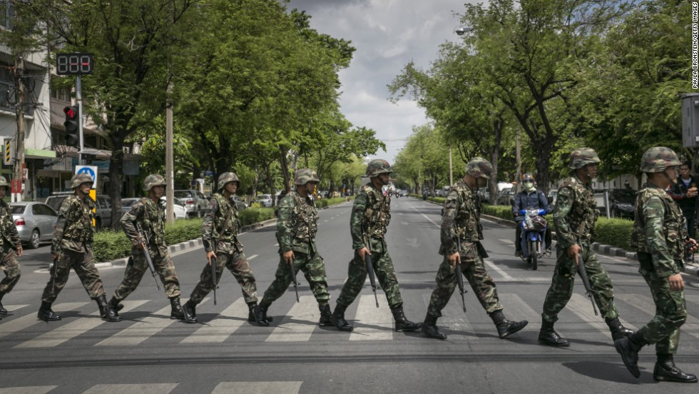 "Thai soldiers patrol near government buildings in Bangkok on Friday, May 23. Thailand's army announced the previous day that it has taken control of the country in a coup, just days after it surprised the government by declaring martial law.  <a href=""http://www.cnn.com/2014/05/19/asia/gallery/thailand-crisis/index.html"" target=""_blank"">See the Thai army impose martial law before the coup.</a>"
