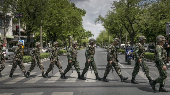 Thai soldiers patrol near government buildings in Bangkok on Friday, May 23. Thailand's army announced the previous day that it has taken control of the country in a coup, just days after it surprised the government by declaring martial law.  See the Thai army impose martial law before the coup.