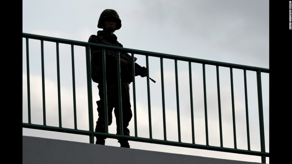 A soldier stands guard on Thursday, May 22, in Bangkok.