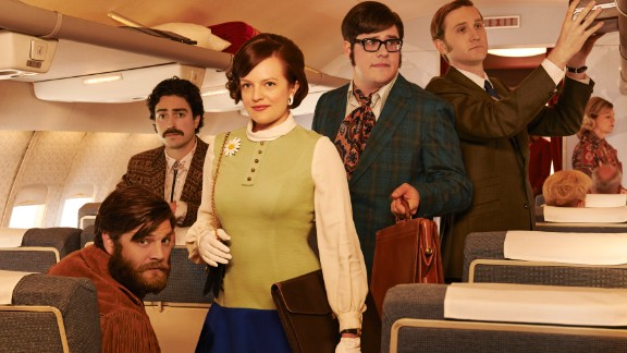 Stan Rizzo (Jay R. Ferguson, seated), Michael Ginsberg (Ben Feldman), Peggy, Harry Crane (Rich Sommer) and Ken Cosgrove (Aaron Staton) on a plane in season 7. Ken is missing the eyepatch he's had to wear since an unfortunate shooting accident in season 6.