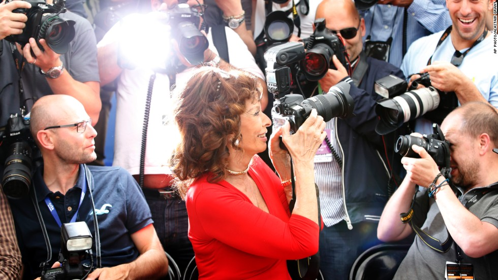 MAY 22 - CANNES, FRANCE: Actress Sophia Loren takes a photo as she sits with photographers during the 67th international film festival in Cannes. The legendary Italian film star, who is turning 80 this year, introduced her newest film, The Human Voice.
