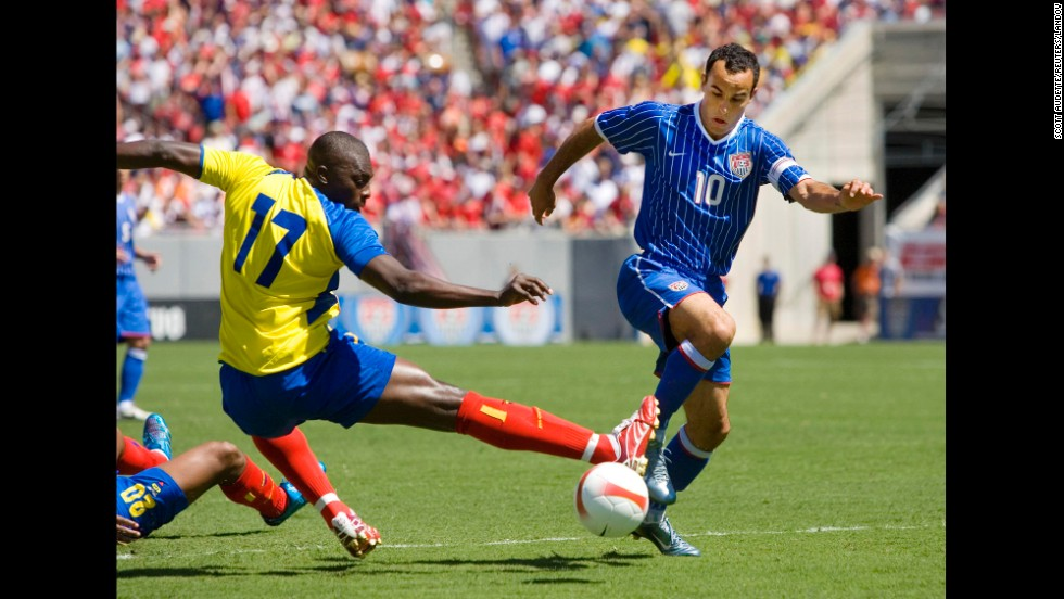 Donovan slides the ball around the outreached leg of Ecuador's Giovanny Espinoza in a 2007 international friendly match in Tampa, Florida. It was one of his three goals in the 3-1 win.