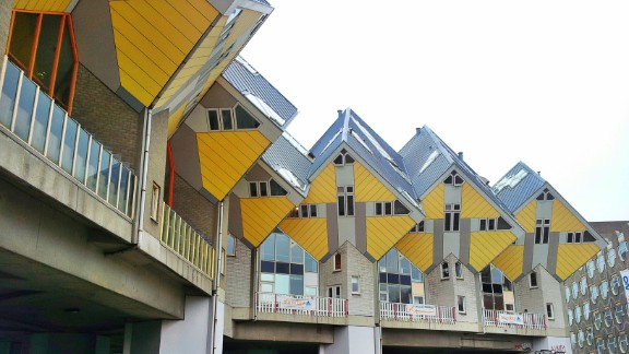 The Cube Houses in Rotterdam and Helmond in the Netherlands were designed to open up space on the floor by creating living spaces up on the roof. Thai Dang was intrigued to learn that people live inside these geometric homes.