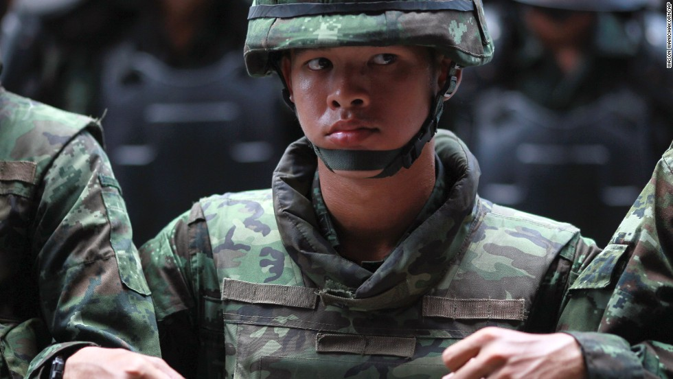 Thai soldiers link arms as they monitor a protest outside a Bangkok shopping complex on May 24.