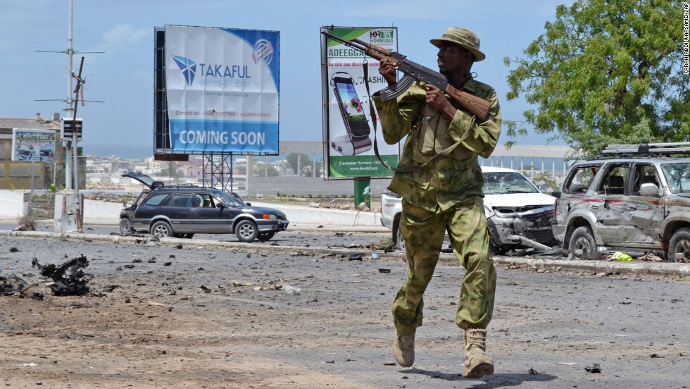 An armed Somali soldier runs to fight during an attack on the parliament in Mogadishu, Saturday, May 24. Al-Shabaab militants launched the attack using automatic weapons and explosives, leaving several dead and wounded, according to witnesses and officials.