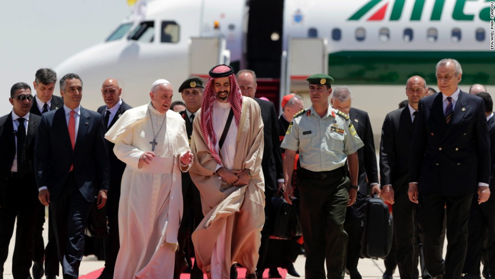 Pope Francis walks with Jordanian Prince Ghazi, chief adviser to the King of Jordan for Religious and Cultural Affairs, on May 24 as he arrives at the  Amman airport.